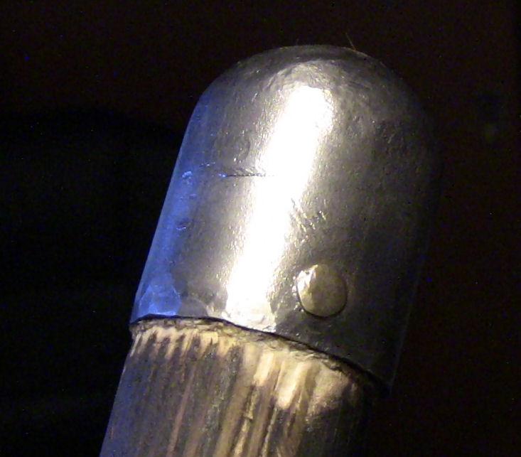 Spear shaft end cap