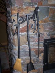 fireplace tools attached to fireplace