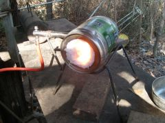 "mini beer keg forge with new  ""up wind"" burner"