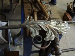 Forming a leaf and fixing to scroll 5 pinned on, wire brushed and waxed