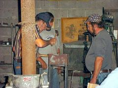 Bill showing Host Randy the finer points of rammable refractory