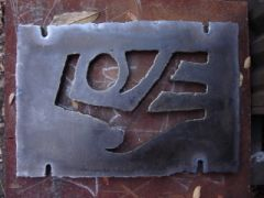 "Wall mount ""Love"" plate sculpture."
