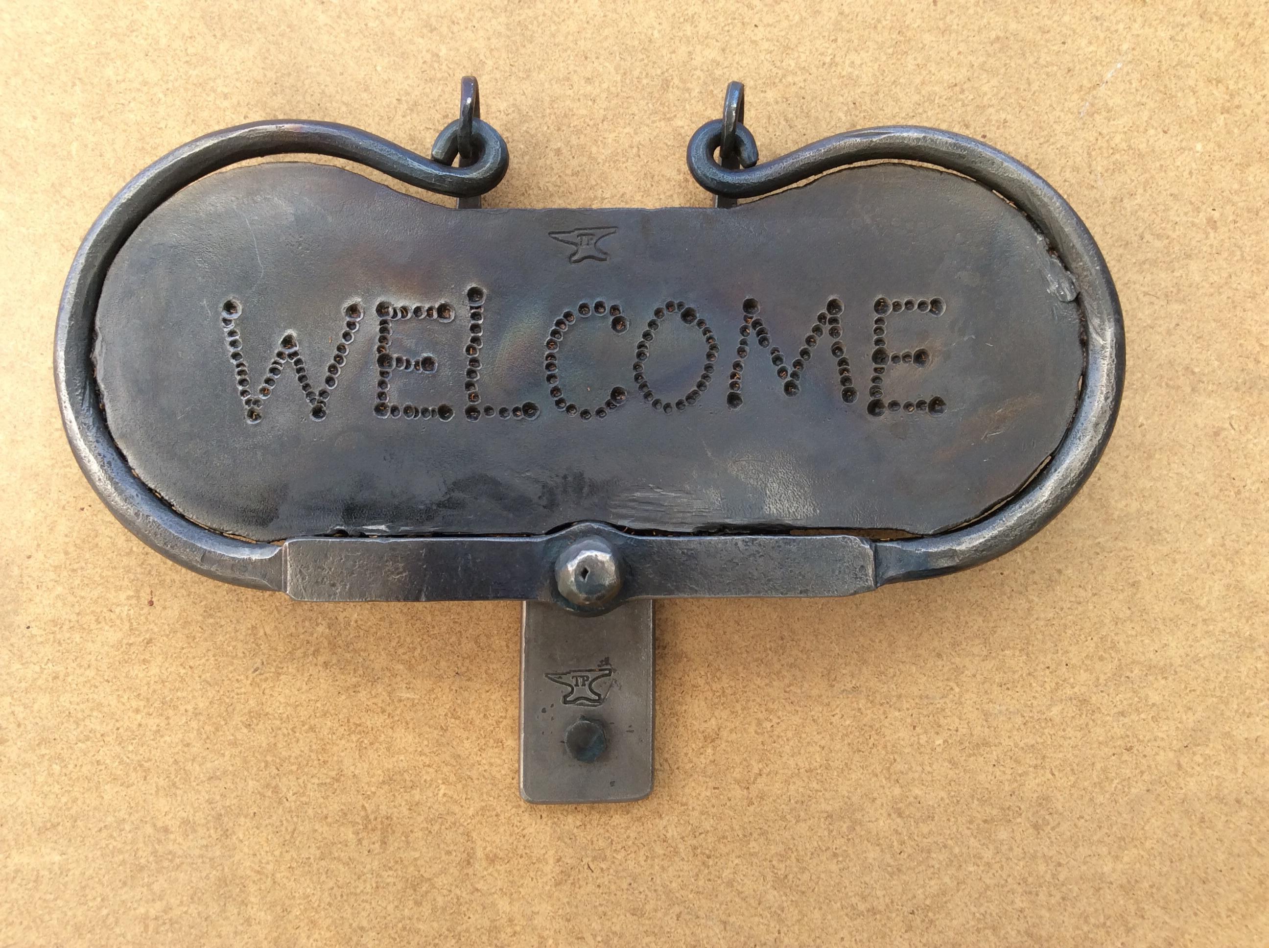 A welcome door knocker