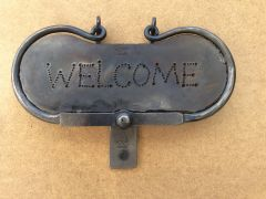 A welcome door knocker