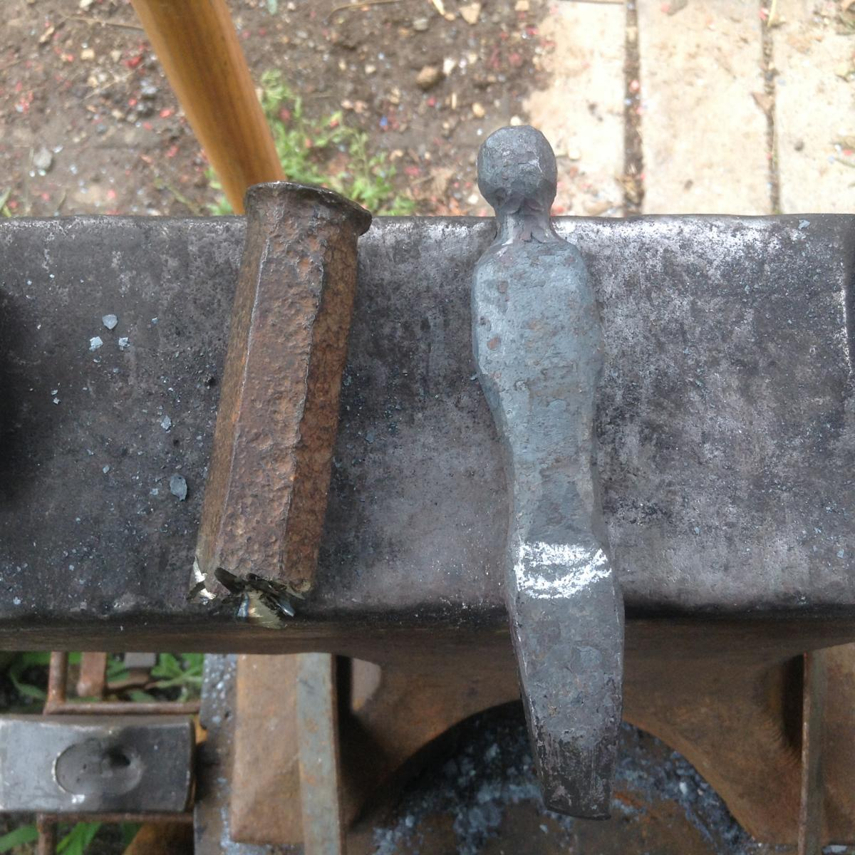 Head and torso forged from old chisel.