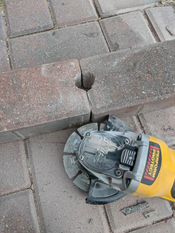 Cutting hole in pavers for blower tube